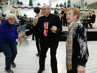 Mayor Stephen Mandel dances with two ladies as Beatles cover band, Pepperland, play a song at city hall during the Come Together: Edmonton's Celebration of Paul McCartney on Wednesday Nov. 28, 2012. Tom Braid/Edmonton Sun/QMI Agency
