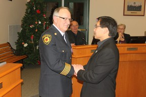 Stony Plain Fire Chief Dan Badry receives the Queen Elizabeth II Diamond Jubilee award this past Monday. Council also unanimously accepted the department's Operational Implementation Report.