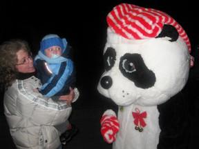 Lyn Stewart and her grandson Emerson met a Christmas panda during Panorama in Simcoe in 2011. The Stewart family from Guelph has visited the annual Christmas light displays for more than 30 years. (Contributed Photo)