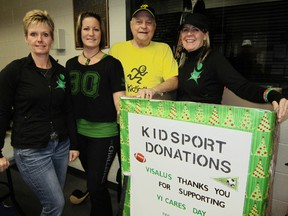 Visalus agent Janine Mandryk of Simcoe, right, is spearheading a drive between now and Dec. 15 to round up good used sports equipment for needy kids in the Norfolk area. Aiding Mandryk in the effort, from left, are Tracey Stewart of Delhi, Kelly Lammens-Pickard of Langton and Doug Souilliere of Port Dover, chair of KidSport in Norfolk County. (MONTE SONNENBERG Simcoe Reformer)