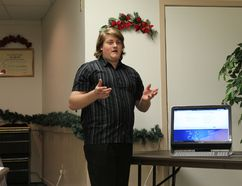 Lynden Beardwood explains how the Gananoque BIA's new website works last Thursday night at the Gananoque BIA's annual general meeting.