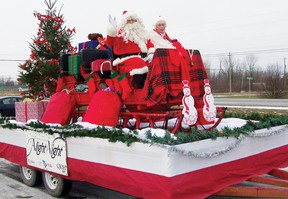 Santa Claus came to town with Mrs. Claus during the annual Santa Claus Parade in Morrisburg on Saturday morning. Staff photo/ERIKA GLASBERG