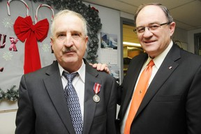 Community member Norman Byrnes was given the Queen's Jubilee 60th Anniversary Medal for his volunteer work with the local food bank, Telecare and through his church, Our Lady of Hope, he was awarded the medal by Nickel Belt MP Claude Gravelle.   GINO DONATO/THE SUDBURY STAR