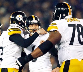 Pittsburgh Steelers kicker Shaun Suisham, centre, of Wallaceburg is congratulated by teammates Drew Butler, left, and Max Starks after kicking a 42-yard field goal with no time left for a 23-20 win Sunday over the Baltimore Ravens on Dec. 2, 2012. (GARY CAMERON/Reuters)