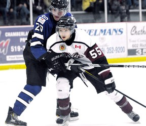 Chatham Maroons' Ian Faubert (55) is grabbed by London Nationals' Keaton Ratcliffe in front of the Nationals' net in the first period Sunday at Memorial Arena. (MARK MALONE/The Daily News)