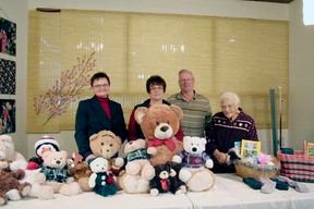 Drayton Valley Cancer Support Group members Eileen Linde, Howard Olsen and Fern Barnay stand with Drayton Valley Health Services Foundation Executive Director Colleen Sekura and just a few of the bears that will be distributed.