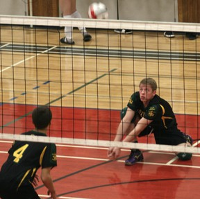 Mitchell Luck (right) playing volleyball for the St. Thomas More Kodiaks. Mitchell will be playing at the high school all-star game in Grande Prairie on this Thursday, Dec. 6, 2012. His father Doug Luck will also be coaching one of the teams at the annual game. (Simon Arseneau/Fairview Post)