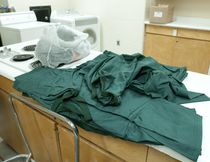Green shirts and pants, worn by female inmates, sit on a countertop in their laundry room at the Elgin Middlesex Detention Centre in London on Tuesday December 4, 2012.  