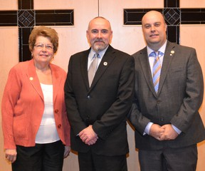 Submitted Photo  Chris Roehrig (centre), director of education for the Brant Haldimand Norfolk Catholic District School Board, stands on Tuesday with June Szeman, who was named  chair, and Rick Petrella, who was named vice-chair, at the board's annual meeting.