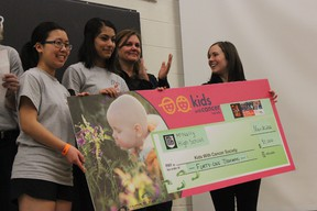 Harman Khinda, centre left, the vice-president of McNally's student union, presents the Kids with Cancer Society with a cheque for $41,000, part of what was raised by the students at the school's annual Bike-a-thon on Nov. 29-30. DALE BOYD Special to the Examiner