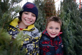 Jonas Weymark-Lang and Brendan Maguire helped to sell trees for the Scouts outside of Rexall Drugs.