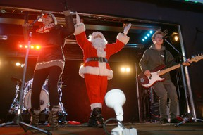 Miss Emily (left) and Jan of the Brothers Dubé (right) welcome Santa to the stage aboard the 2012 CP Holiday Train. The railyard concerts open the side of a train car for the show in 150 communities across Canada. JON THOMPSON/Daily Miner and News