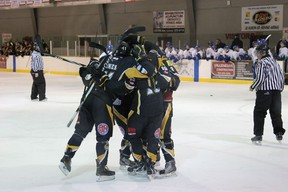 The Abitibi Eskimos celebrating after Aaron Kerr scored the third goal of the game in a three minute span, followed by Ryan Wildman and Richard Therrien.