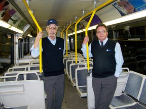 Roger Lascell, left, and Terry Mallette are proud owners of new pins given to them earlier this week for being safe drivers for more then 20 years for Cornwall Transit. Erika Glasberg staff photo