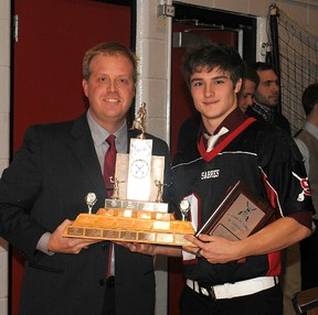 Sabres head coach Cam Fraser proudly presents the MVP award to Patrick Kuny. Photo supplied