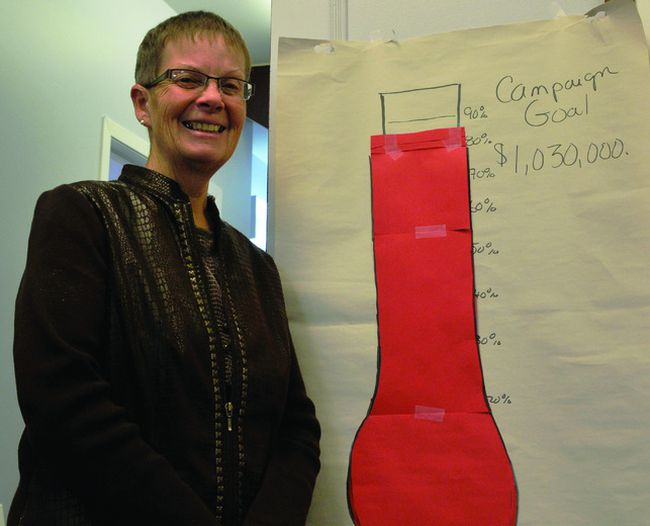 Judi Baril stands at the United Way office with the organization's tracker for the Annual Giving Campaign. Baril says that the 2013 goal of $1,030,000 is expected to be attained.