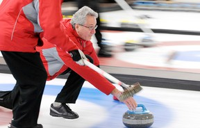 Doug Campbell curls a stone in the second last end of the final at this third annual event.