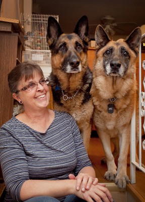 """Maureen Gibson found her """"forever friends"""" in the form of two older German Shepherds, Onyx and Cobalt. She and her daughter Shannon want people to consider adopting less-desireable dogs that are older or large breeds and that often have trouble finding homes, and they are willing to co-sponsor adoption fees for individuals wanting to adopt these types of dogs."""