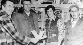 Harry Birch presents Active 20-30 cheques to the winners of the clubs Grey Cup pool (Norman Brasten, Clarence Johnson and Chancey Howe, in this photo from Dec. 1972.
