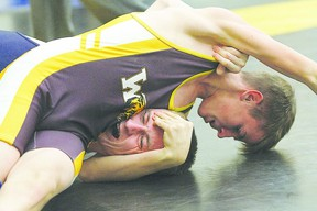 Nakai McDonnell tries to pin Josh Howard during a bout at the Wetaskiwin Wrestling Classic Tournament Dec. 1, 2012.