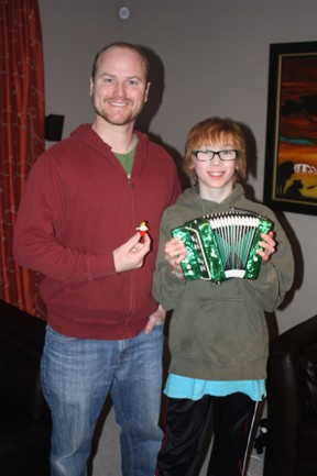 Nathaniel Crossley made his first Lego4Africa trade with Zenon Campbell Saturday, trading up from a small Lego mountain man to a miniature accordion.  SUPPLIED PHOTO