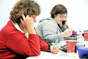 Mary Jo Greenslade, left, and Tara Sikora, work the phones at Home James taking information in order to get clients and their vehicles home safely during the weekend.  The group depends solely on teams of volunteers to to run the not-for-profit program that combats drunk driving. DIANA MARTIN/ THE CHATHAM DAILY NEWS/ QMI AGENCY