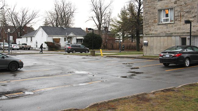 The parking lot between Morris and McNeill Halls is the location for one of two new student residences announced by Queen's University. (Michael Lea The Whig-Standard)