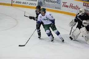 arrett Zentner of the Melfort Musatngs jostles for position with a player from the Battlefords North Stars during the Mustangs' 5-2 loss at the Northern Lights Palace on Friday, Deember 6.