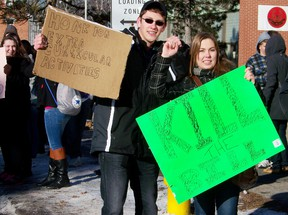 Cornwall Collegiate and Vocational School students Jonah Gillard and Sam Carriere stood in protest of Bill 115 during a student walk-out on Tuesday afternoon.  ERIKA GLASBERG/CORNWALL STANDARD-FREEHOLDER/QMI AGENCY