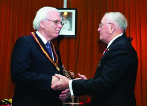 Outgoing warden Mel Campbell, right, passes the gavel to new Leeds and Grenville counties council warden Ron Holman at an inauguration ceremony held on Wednesday morning (ALANAH DUFFY/The Recorder and Times).
