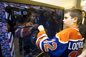 Ethan Lockwood, 11, plays a demolition derby game at the newly opened Oilers Interactive Learning Centre at the Glenrose Rehabilitation Hospital in Edmonton, Alta., on Wednesday, December 5, 2012. Ian Kucerak/QMI Agency