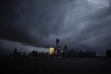 The skyline of lower Manhattan,  as seen from Exchange Place, is mostly in darkness except for the Goldman Sachs building after a preventive power outage caused by giant storm Sandy, in New York October 30, 2012.  REUTERS/Eduardo Munoz