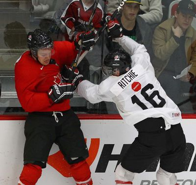 Canada's National Junior Team Whites, Brett Ritchie, and Team Red's, Griffin Reinhart during game action at the National Junior team selection camp Dec 11-13, 2012 in Calgary, prior to the World Junior championships that starts Dec. 26 in Ufa, Russia on Tuesday Dec 11, 2012. Darren Makowichuk/Calgary Sun/QMI AGENCY