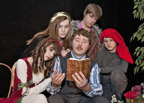 BRIAN THOMPSON, The Expositor  Walt (James Diamond) reads his story to (from left) Snow White (Sarah Almeida), Stinky (Alex Draper), The Huntsman (Jake Ford) and Angry (Cooper Bilton) during a rehearsal of Brant Theatre Workshop's presentation Snow White and Not The Usual Dwarfs.