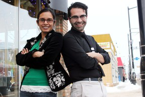 Natasha Deen and Omar Mouallem, the Edmonton Public Library's new writers in residence, pose for a photo outside of the Carrot Cafe on 118 Avenue on Monday. DALE BOYD Special to the Examiner