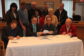 Board members of the CCBCC, town administration and town council gathered together to commemorate the signing of the joint-development agreement between the Town of Beaumont and the CCBCC.