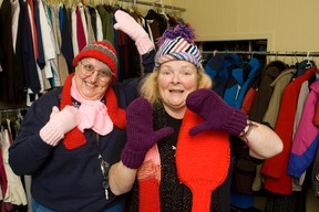 Phyllis Contois, left, and Donna Atkinson-Wilson have been knitting scarves, hats and mittens for homeless teenagers for 10 years. On Friday the women invite the public to participate in a Christmas sing-a-long in the downtown.