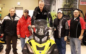 Mikey's General Sales donated a brand new snow machine to the Timmins Snowmobile Club on Friday, doing their part in ensuring the safest trails possible for the Timmins community. From left are Gilbert Fortin, Ivan Dery, Mike Mason, Hector St. Jean and Marc Drouin.