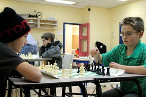 Johnny Burn and Benjamin Farrington, both 11, play a game of chess at the Fort McMurray Chess Club at the YMCA last year.