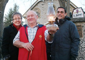 The congregation of St. Andrew's United Church in Williamstown is wrapping up its 225th anniversary with a kerosene lit Christmas Eve service. From left are St. Andrew's minister, Rev. Andrea Harrison, lamplighter Stanley Swerdfeger, and board of governors chair Mike Seguin. Staff photo/GREG PEERENBOOM