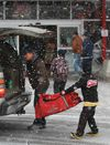 A dad and son get their hockey gear out of the car during a snow squall at the Bell Sensplex in Ottawa Sunday, Dec. 16, 2012. Snow, ice pellets and freezing rain have been falling across the city since Sunday afternoon. Tony Caldwell/Ottawa Sun/QMI Agency