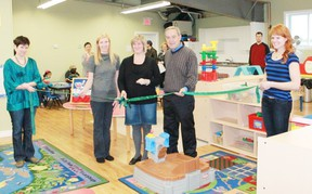 Pictured (left to right) Board member Linnea Catalan, President Tanya Stepaniak, supervisor and teacher Dorothy Chubb, Mayor Mike Smith, board member Katherine Martinko as they cut the ribbon to celebrate the Kids Street Cooperative Nursery School newly renovated and enlarged space on Dec. 9.