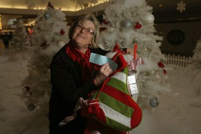 Chief Executive Officer/Director of Public Libraries Liz Rossnagel holds Shop Til You Drop raffle tickets. Proceeds from sales of the tickets will go to the Friends of the Libraries who plan to purchase additional copies of e-book titles for the Sault Public Libraries. The $5 tickets are for a chance to win a $5,000 shopping spree at the Station Mall. The Friends of the Library have been supporting literacy activities of the Library for more than 20 years.