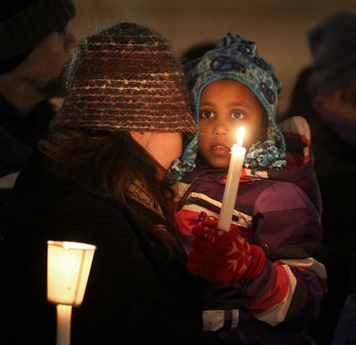 Mourners hold candles during a vigil in Winnipeg, Man. Monday Dec. 17, 2012 for former Winnipegger Ana Marquez-Greene who was killed in the Newtown, Connecticut school shooting. BRIAN DONOGH/WINNIPEG SUN/QMI AGENCY