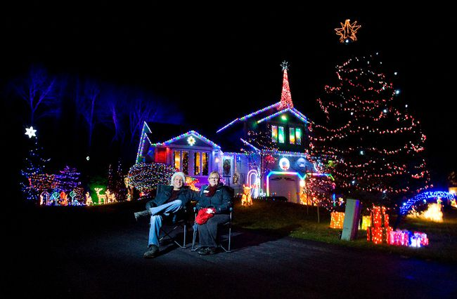 Dennis Taylor and Raymie Jewell  have more than 65,000 Christmas lights on and around their home in Port Stanley. (DEREK RUTTAN The London Free Press)