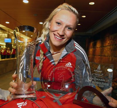 Canada's golden girl of bobsleigh, Kaillie Humphries shows off some of her medals as she returned home to Calgary for the holidays. The 27-year-old reigning Olympic and World Champion is having the bobsleigh run of her life, rattling off an historic eight straight victories. (Darren Makowichuk/QMI Agency)