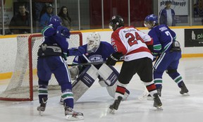 Blind River Beavers forward Tyson MacLeod (24) battles for the puck in heavy traffic on Saturday, Dec. 15 at the Blind River Community Centre. Photo by REG CLARK/FOR THE STANDARD