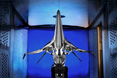 A subscale model of a potential future low-boom supersonic aircraft designed by the Boeing Company that has been installed for testing in the supersonic wind tunnel at NASA's Glenn Research Center in Cleveland, is shown in this photograph released on October 17, 2012. The tests are among those being conducted by NASA and its partners to identify technologies and designs to achieve a level of sonic boom so low that it barely registers on buildings and people below. REUTERS/Michelle M. Murphy/NASA/Handout