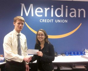 Pictured: Meridian Branch Manager Richard Huizinga presents a cheque to Southampton Art Gallery director Alanna Young.