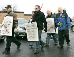 Members of Brantford District Labour Council affiliates march on MP Phil McColeman's office on Tuesday, Dec. 11, 2012, to protest Bill C-377. (CHRISTOPHER SMITH/QMI Agency)